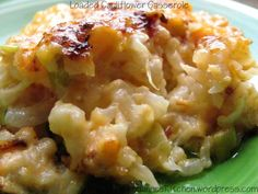 Loaded Cauliflower Casserole ~ combine shredded cheddar, monterey jack, and cream cheese; stir in sliced green onions, cooked chopped bacon and garlic; add and stir in drained steamed cauliflower florets; pour into baking casserole, sprinkle on more cheese, bake until bubbly and browned; serve and enjoy!
