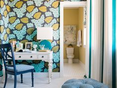 The eye-catching blue and green floral wallpaper is a show-stopper in this vibrant space, where modern design details and a cozy nook round out the look.
