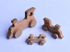 Locomotive - wooden vehicle. Wooden toys on wheels. They are made by hand from solid alder wood, all parts are made of wood and is a completely