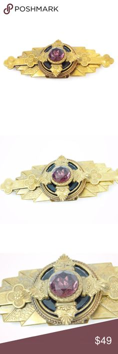 """Art Deco Style Brass Brooch Pin w/ Crystal Center Art Deco Style Brass Brooch Pin with Purple Crystal Center  We can't say enough about this amazing brooch! Very unique and detailed. A gorgeous purple crystal adorns the center of this brooch pin.  Decade unknown, could possibly be original Art Deco Well made, substantial piece Brass metal Purple crystal in center Traditional pin in back Length 4"""" W x 1.5"""" H  Condition: No major flaws. Light tarnishing and slight scratching from normal wear…"""