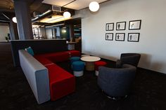 The common space is huge and has a lot of modern-feeling furniture in it—with bold circular and square shapes.