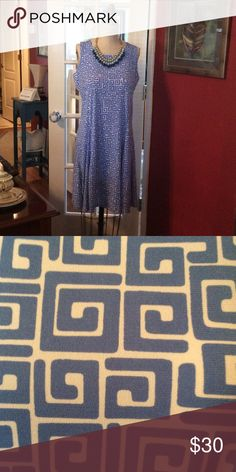 Never Worn Blue & White Dress Soft Federal Blue and White Pattern Sleeveless  dress.  Fabric has some stretch to it.  Second picture gives more of the true color. Susan Graver Dresses Midi