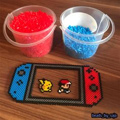 A nintendo Switch control made with mini and midi beads. - Switch Nintendo - Switch Nintendo for sales - - A nintendo Switch control made with mini and midi beads. Perler Bead Mario, Pokemon Perler Beads, Diy Perler Beads, Pearler Beads, Mini Hama Beads, Melty Bead Patterns, Hama Beads Patterns, Beading Patterns, Peyote Patterns