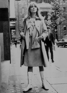 Nico in trench coat. Shades of Mad Men: she was the Face of London Fog.