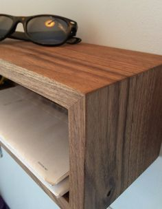 Our Floating Entryway Organizer is handmade from a single hardwood plank, highlighting a continuous wrap-around grain.  Available in 4 lengths, this floating shelf mounts quickly and easily with an integrated french-cleat. We embed 3 rare-earth magnets on the underside for keys. The shelf depth is perfect for sunglasses, wallets, phones and your mail. Your choice of Black Walnut (shown), White Oak or Maple  See this piece in solid Maple here; https://www.etsy.com/listing/4...