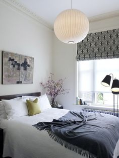 Charles Mellersh renvovation of Victorian terrace in Notting Hill, bedroom with George Nelson Bubble Lamp and Kelly Wearstler blinds | Remodelista