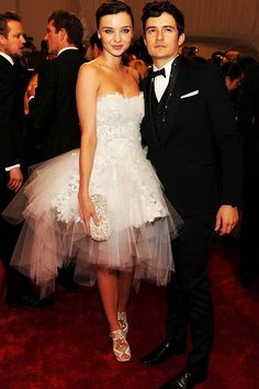 Miranda Kerr in Marchesa dress and Nicholas Kirkwood shoes with hubby Orlando Bloom
