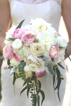 Soft, romantic and elegant bouquet with garden roses, peonies, ranunculus and hydrangea.  This classic design includes all white, ivory and blush toned blooms. Designed by Bella Flora 30a.