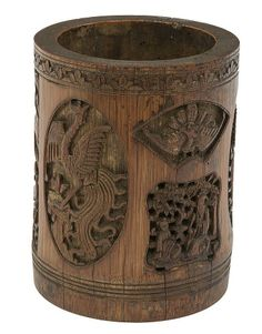 A 19TH CENTURY CHINESE CARVED BAMBOO BRUSH POT, carved in deep relief with numerous figures amongst foliage; an oval panel with a phoenix; and a fan shaped panel with a peacock, 7in (17cm), bears inscription in ink to base