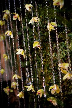 Hang flowers from long crystal beads.  Inexpensive and elegant!