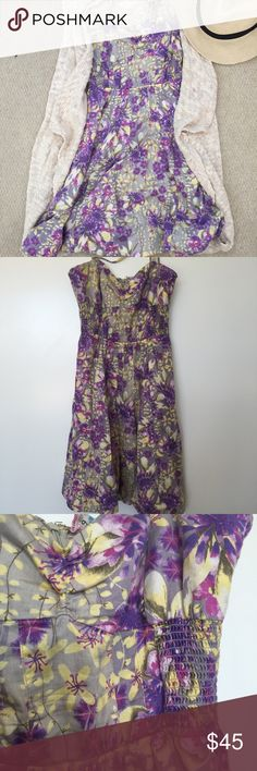 Free People Strappy Sun Dress The straps can either tie in the back or be tucked in for a strapless look. Floral print, elastic around the middle for a fitted look. 100% cotton. Has pockets! Size 6. Goes great with the Exhilaration vest in my closet! Free People Dresses Mini