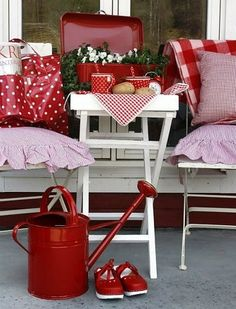 I like the simplicity of this porch and of course, the colors red and white!