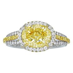 Fancy Yellow Diamond Engagement Ring | From a unique collection of vintage engagement rings at http://www.1stdibs.com/jewelry/rings/engagement-rings/
