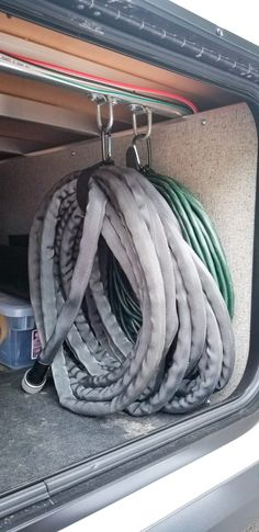 Camper Hacks Discover Simple RV Storage Organization Hack This simple easy and effective RV storage hack will organize all of your cords wires or hoses in a pinch with just 4 hardware items! Rv Camping Tips, Travel Trailer Camping, Camping Storage, Rv Storage, Camping Ideas, Travel Trailers, Rv Tips, Storage Hacks, Camping Checklist