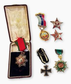 Turkish Order of the Medjidieh in original case of issue, Order of the Osmarieh 4th class, two Turkish World War I medals, a World War I German iron cross and a cigarette card album (1 box) Estimate £250.00 to £350.00 (Lot no: 323 in sale on 21/10/2014 - The Cotswold Auction Company)