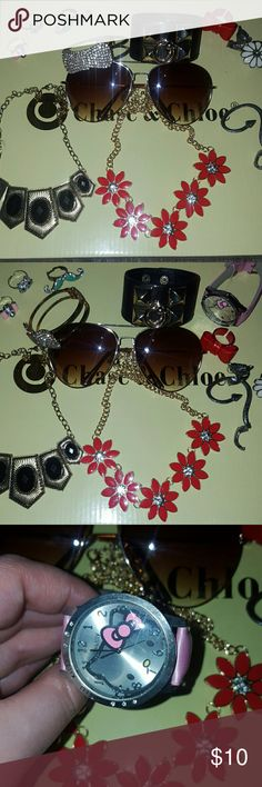 Cuff bracelet sunglasses rings tribal necklace 12 RANDOM PIECES  Good condition   6 rings  Hello kitty , camera , mustache , bow , daisy ,fox  2 cuff bracelets  Rhinestone bow & stud cuff  1 sunnies 1 snake wrap around cuff earring  2 necklaces Red flower & gold black deco   slight discoloration on chain blk/gold necklace (not really noticeable) Jewelry