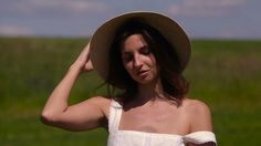 Young Girl In White Dress And Straw Hat #Black, #Dress, #Field, #Girl, #Green, #Hair, #Head, #Knyaz333, #Long, #Raises, #Site, #Slowmotion, #Stands, #Straw, #White, #Young http://goo.gl/UYjYBl