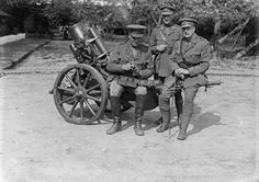 MINISTRY INFORMATION FIRST WORLD WAR OFFICIAL COLLECTION (Q 2482)   Examining the sights of a captured German trench mortar; Third Army Trench Mortar School, 20th May 1917.