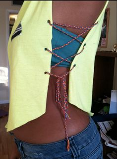 Lace-Up Side Tank...Just cut off the arms of the t-shirt, cut the sides, snip some small holes, and lace-up the sides with some braided string.