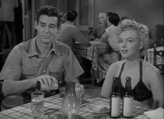 """Marilyn Monroe and Robert Ryan in a scene from """"Clash By Night"""", 1952."""