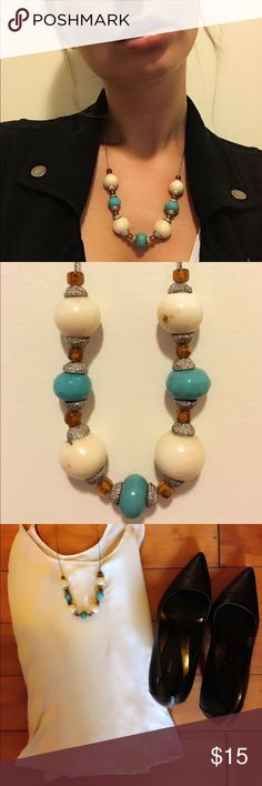 Never worn. Medium length necklace. Off white and turquoise with an accent of silver and auburn. Jewelry Necklaces