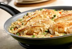 This quick-cooking, creamy risotto features chicken, carrots and peas enhanced with the flavor of mushrooms and roasted garlic.