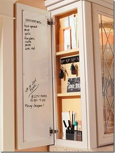 Behind a small cabinet door, a marker board comes in handy for writing the grocery list or a note.