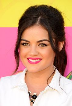 Lucy Hale: Lucy Hale paired a loose ponytail with an electric pink lip color for her walk down the orange and purple carpets.
