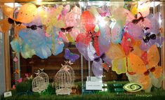 """Premier Optical spring Window Displays Spring Window Display 2014  A swarm of butterflies head across the window... most of them started out as children's party favor """"fairy wings"""" from the dollar store!"""
