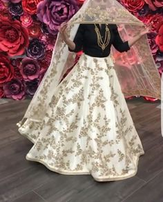 White bridal lengha with gold details by vivah collections