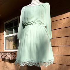 LOWEST Green sheer and lace dress Size large green dress with lace! Lace is along the bottom and back is sheer. There are spots for a belt but there is no belt so you could add one if you wish. Has sleeves and no flaws! Bust- approx 21 in, waist- stretches to approx 22 inches, length- approx 36 in All pictures are taken in natural light so color may vary. Comment with ?s. I do not trade. Price firm. Takara Dresses Midi