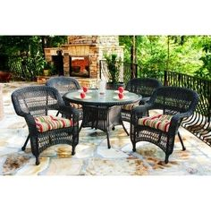 """Portside 5 Piece Dining Set Fabric Color: Haliwell Caribbean, Finish: Dark Roast by Tortuga Outdoor. $849.00. PSD-DR HALIW Fabric Color: Haliwell Caribbean, Finish: Dark Roast Features: -All-weather wicker.-Durable powder coated steel frames.-Unlike natural wicker, all-weather wicker is stain, water, UV, crack and split resistant.-Tempered glass 5/32"""" thick. Includes: -Set includes: 4 dining chairs and 1 dining table.-Umbrella hole and cover included.-Some assembly ..."""