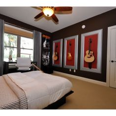 Love the frames around the hanging guitars, could even put padded panels within each frame for sound-proofing.
