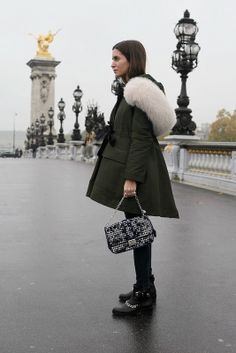 Gala Gonzalez in a green fur-lined coat + skinny jeans + black ankle boots