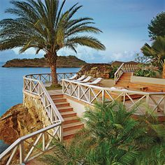 Travel Photograph - Seaside Resort With Stairs And Palm Tree by Durston Saylor