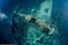 Haunting: The remnants of fighter planes - including this US F6F-3 Hellcat - shot down during a mighty Second World War battle have been pictured 185ft feet underwater