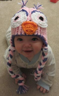 This is a handmade knitted owl hat made for sizes newborn to 6 months. This hat can be worn for cold weather, everyday use, and for special occasions like Halloween, Christmas, birthdays, Easter, baby shower gifts, etc... Machine wash and dry. Different size and color requests are welcome, please contact me.   Please contact me if you have any questions about this item or other items i have for sale. Designed by Simply Yarn...