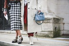 How French Girls Do Street Style For Fashion Week  #refinery29  http://www.refinery29.com/2016/03/105661/paris-fashion-week-fall-winter-2016-street-style-pictures#slide-45  Give your gingham some edge with a seam lined with grommets....