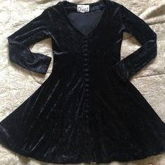 Vintage black velvet skater dress with buttons Very 90s Lon sleeve goth black velvet skater dress is so cute and trendy. Soft and stretchy crushed velvet material and velvet buttons to add the perfect detail. In good vintage condition, with some signs of wear, but nothing major. Size small. Vintage Dresses Long Sleeve