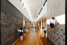 Playful hallway installations; climbing and chalkboard wall. Opportunities for indoor play and personalization of space. Kindergarten by Hibinosekkei and Youji no Shiro