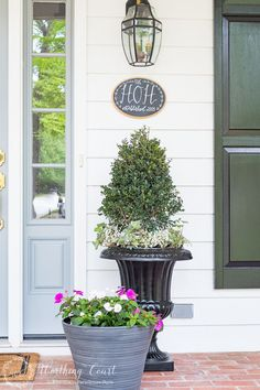 Farmhouse style doesn't have to mean fussy or complicated or having a space filled to the brim with chotchkies. When it comes to outdoor spaces and landscaping, I much prefer clean, groomed lines. Thus my choice of just a few planters that flank my front door. Matching boxwoods in black urns with green and white ivy and polka dot plants are a classic. As summer progresses the ivy will trail down the sides and the polka dot plants will fill out and create and eye catching spot of brightness…
