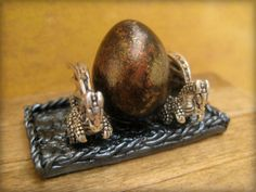 Hey, I found this really awesome Etsy listing at http://www.etsy.com/listing/120160275/dragon-egg-in-dollhouse-miniature