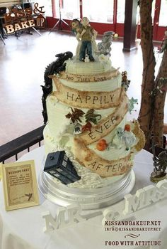 The ultimate geek wedding cake…I really like the idea of having a cake with all of our favorite things kind of stuffed into one big topsy turvy cake.