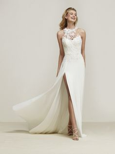Dramis: Flared wedding dress with sensual split that creates a beautiful movement effect and lace back - Pronovias