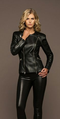 Blonde in black leather pants and form fitting leather jacket