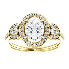 GEORGIA is what dreams are made of. Halo-style 3-stone engagement ring with accents.