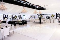 wedding reception hall... i love the black and white decor. (So clean, modern and sleek!)
