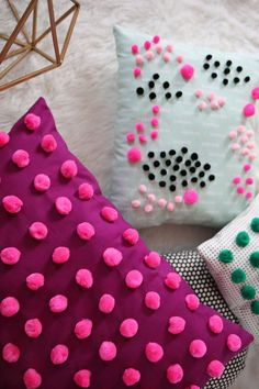 DIY - Pom poms pillows for a textured effect by abeautifulmess.com