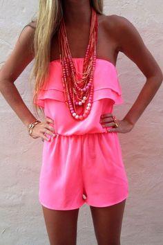 Neon pink strapless romper.