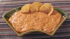 Chili Cheese Crockpot Dip-2 (8 oz.) cream cheese  2 (15 oz.) cans of chili, (with/without beans)  2 cups shredded cheddar cheese (I use medium cheddar)  cayenne pepper  salt and pepper  tortilla chips